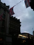 Union Jacks and a double-decker bus in the twilight before the wedding