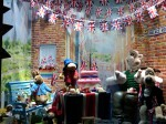 Treasured British characters share a celebratory tea on Regent Street window display
